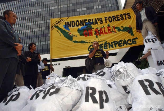 "Greenpeace activists dress as entrepreneurs and enact a 'street market' auction under a banner stating ""Indonesia's Forests on sale"" and a map of forest areas to be auctioned to highlight the Indonesia Forestry Ministry's latest plans of auctioning of..."