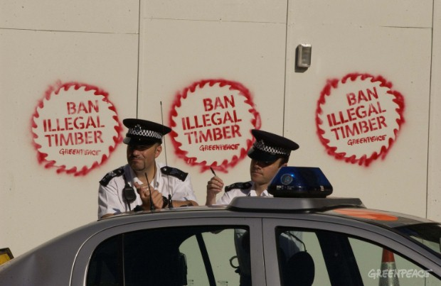 Police at a Greenpeace protest at the Admiralty Arch wing of the Cabinet Office in London. Greenpeace were protesting the use of illegally logged rainforest timber in the building's refurbishment.