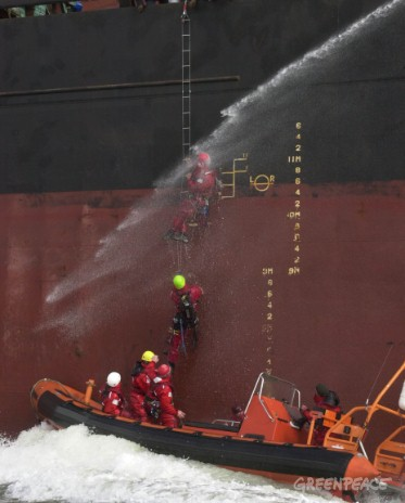 Greenpeace activists boarding the MV Balaban 1, a ship delivering illegally logged Amazon wood.