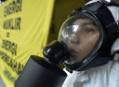 Greenpeace activist wears a gas mask in protest