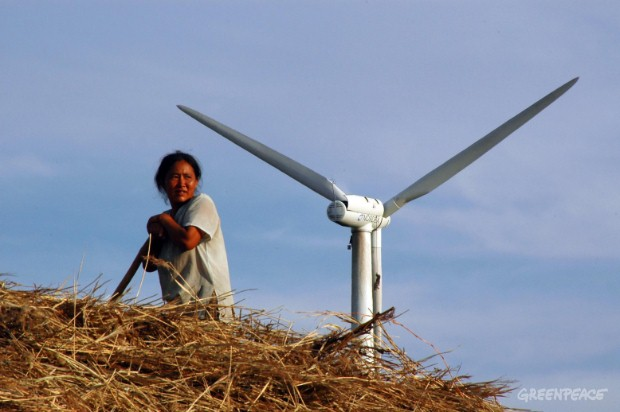 Chinese woman works below 21st century renewable energy technology.