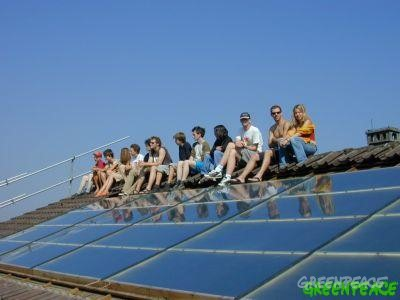Members of the Solar generation project on a solar panel roof.
