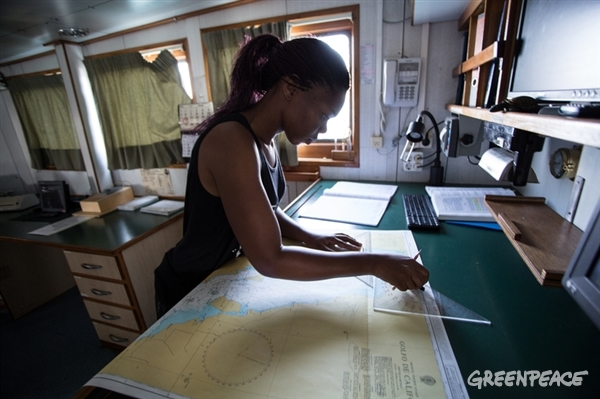 Tulepka, a crew member of the Espy, reviews a map of the Gulf of California in order to chart the best route for the ship. July 19, 2015. © Greenpeace