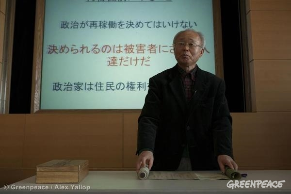 Katsutaka Idogawa, the former mayor of Futaba town presents his family tree, which he brought from his old house in Futaba town to his new house in Kazo city, where he evacuated after the disaster of Fukushima Daiichi nuclear power plant. 02/19/2014 © Greenpeace / Alex Yallop