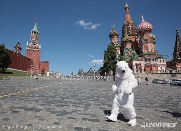 A Greenpeace activist dressed as polar bear on Moscow's Red Square demands immediate global action to protect the Arctic. The activity is part of the 'Arctic Rising' actions which follow the rising sun across the globe on the longest day, June 21st. Greenpeace is campaigning for a global sanctuary around the north pole, and a ban on oil drilling and unsustainable fishing in the wider Arctic.