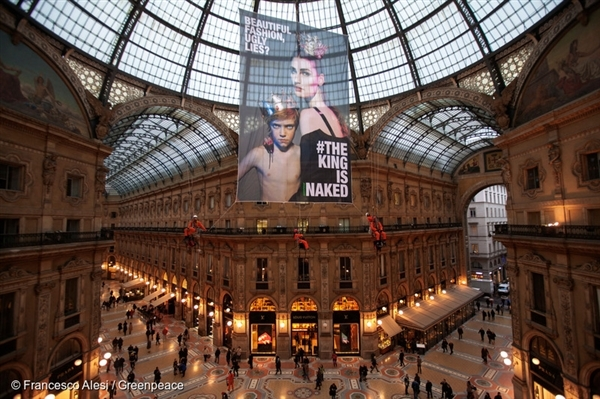 "Greenpeace activists unfurl a 100 square metre banner hanging from the iconic Galleria Vittorio Emanuele with the text ""The King is Naked"" heralding the start of Milan Fashion week in Milan, Italy."