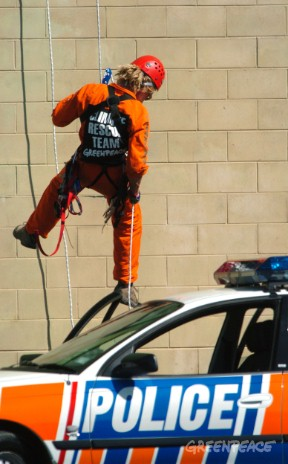 Greenpeace activist Raoni Hammer lowers himself into the police