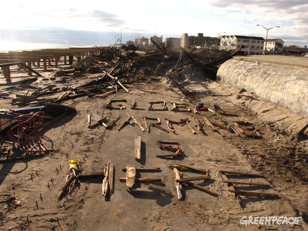 "A message written in debris from Hurricane Sandy reads ""Global Warming is Here"" on the beach in a devastated area of New York. The late season hurricane drew unusual power from a warmer than usual ocean and devastated coastal New York and New Jersey. 11/04/2012 © Greenpeace"