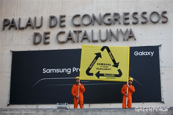 Greenpeace protests outside the Palau de Congresos de Cataluña (Catalunya Palace of Congress) during the presentation of Samsung ahead of the Mobile World Congress