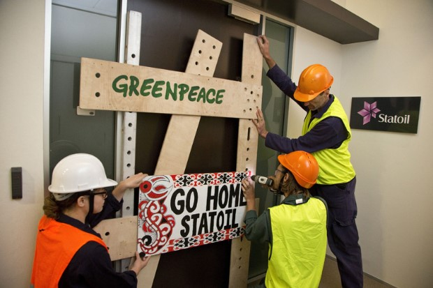 Greenpeace activists barricading shut Statoil's new Wellington office.