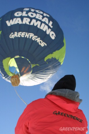 Greenpeace worker holds the teather of the Balloon near the Utah Olympic Sports Park.
