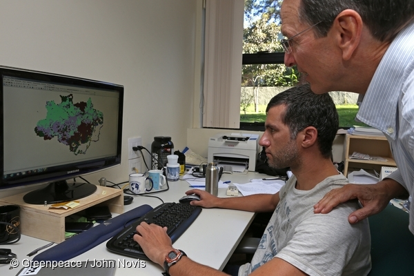 Researcher Bernardo Ruddorf (right foreground) inspects a satellite image for developing methodologies in agriculture at INPE (National Institute for Space Research), São José dos Campos, São Paulo. 16 Jul, 2013  © Greenpeace / John Novis