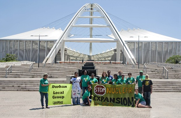 Activists outside Durban's Moses Mahbida stadium calling for Renewable Energy Now