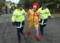 Ronald McDonald is arrested by police after locking himself to McDonalds distribution centre