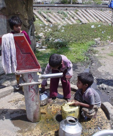 Despite red markings on handpumps to indicate that the water is too contaminated to be used, the community in Bhopal has no option but to use this water.