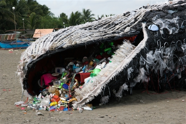 art installation depicting a dead whale choked by plastics, in Philippines
