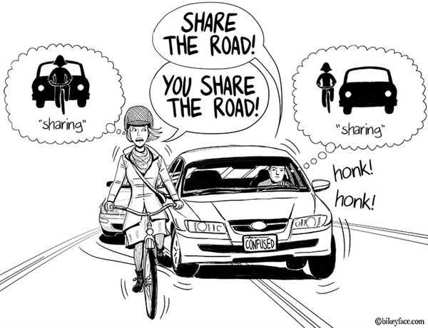 Cyclist getting asked by a car drive to share some road space