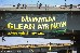 Activists hang a banner on Vashi bridge that reads Mumbai Clean Air Now.