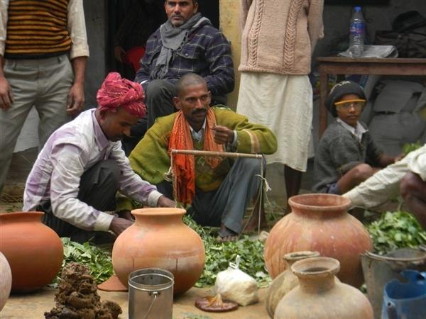 Farmers prepare amritpani in a training camp