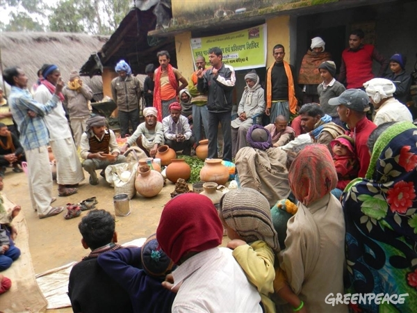 Kedia farmers gather around for a discussion