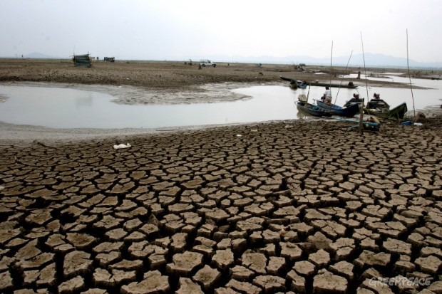 Waters in Lam Takong Dam in Korat, Nakhon Ratchasima province of Thailand have dried up due to prolonged drought, allowing villagers to camp inside the dam to catch the remaining fish.  Greenpeace linked rising global temperatures and climate change t...
