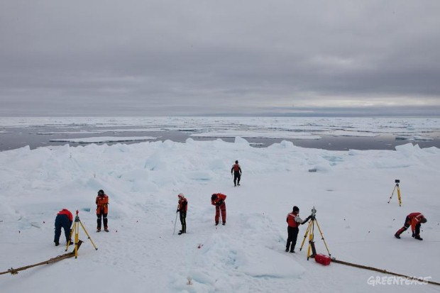 Experts at work on an arctic ice floe