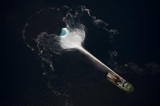 A fire ship hoses down an iceberg