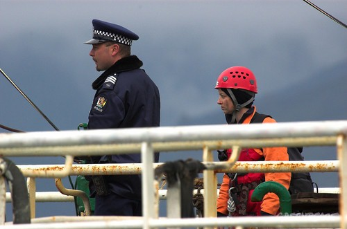Greenpeace activist is escorted off the Belize flagged Chinese bottom trawler in Port Nelson after stopping it leaving port.