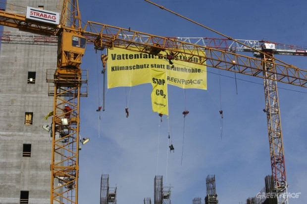 Greenpeace activists climb on seven cranes at the coal power plant building site of Vattenfall in Boxberg. They hang a huge Banner from the crane reading: Vattenfall: Stop building! Climate protection instead of brown coal! Smaller banners at the othe...