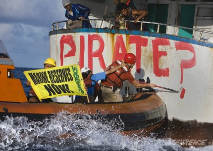 "Greenpeace activists paint ""Pirate?"" on the back of Taiwanese longlinger in Pacific international waters. May 3rd 2008"