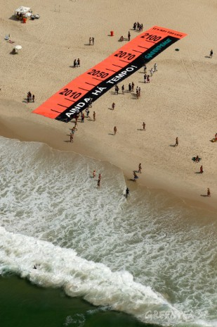 "A 131 foot banner simulating a ruler for measuring the sea level, and bearing a message ""It's not too late"" on Copacabana Beach. Rio de Janeiro is one of the Brazilian cities morevulnerable to the rising of the ocean level."
