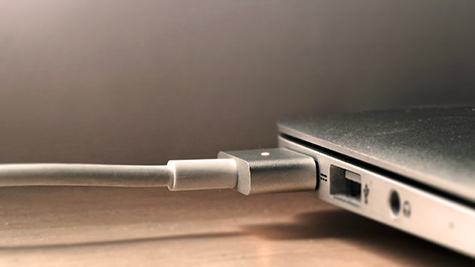 Photo of MacBook Air and charger.